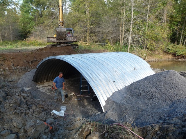 The Service's New York Field Office used this bottomless culvert, shaped like an arch, to simulate a more natural environment for fish. The project opened 18 miles of waterway.