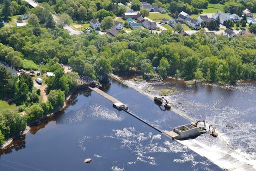 Excavators begin dismantling Great Works Dam. Photo from Penobscot River Restoration Trust.