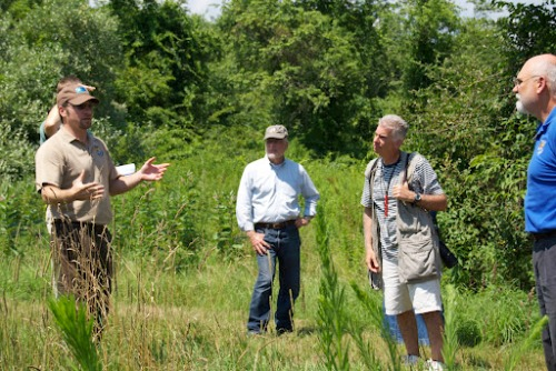 Service biologist Ted Kendziora talking with NRCS Chief Dave White and others at the farm. Photo courtesy of Tom McAvoy.