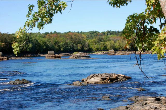 These two images show the Great Falls dam site before and after removal in summer 2012. Photos courtesy Penobscot River Restoration Trust