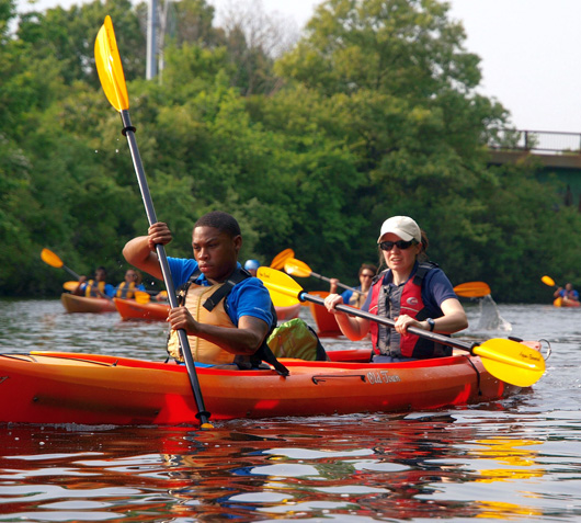 De'Andre Brown, a 2012 intern, kayaking on the Charles River in Massachusetts. Credit: Lamar Gore/USFWS