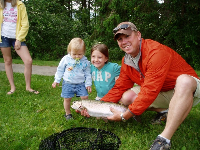 Family with their catch at the Northeast Fishery Center's annual fishing event in Lamar, PA. Credit: Joe Vickless/USFWS