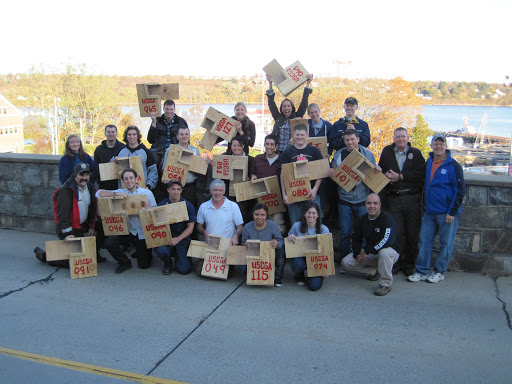 Staff and students pose with roseate tern nesting boxes.