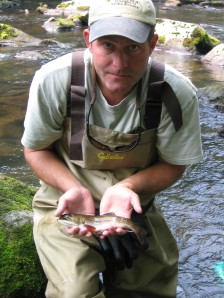 Chesapeake Bay coordinator Mike Slattery holds a brook trout from Savage