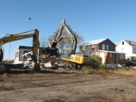 Demolition of the abandoned cottages. Credit: Patrick Comins.