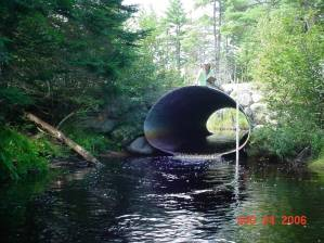 This road crossing culvert is perched too high for fish to get through. Constricted flow creates a high-velocity barrier that migrating aquatic animals can't swim through. Find out what's being done in E. Peter Steenstra's story, SHARE Downeast at www.fws.gov/eddies. Credit: E.Peter Steenstra/USFWS