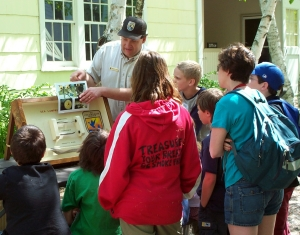 A man shows children sea lamprey educational materials