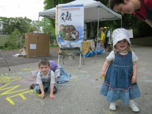 Kids were also invited to draw endangered species (or maybe just shapes!) on the ground around our booth. Credit: USFWS