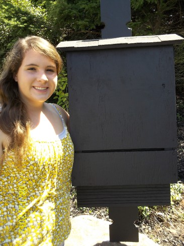 Photo of Jessica with a bat box