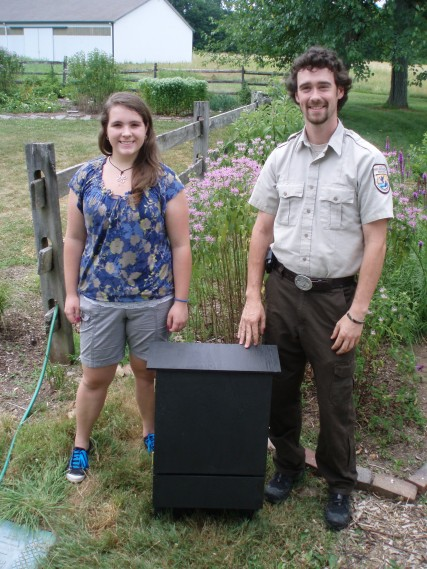 Girl Scout Jessica Lukaszek stands behind her donated bat box with visitor services specialist Dave Sagan at Great Swamp National National Wildlife Refuge.