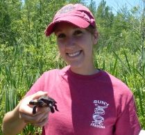 I'm Bethany Holbrook, and I work at our New York Field Office. You'll be hearing from me every week! Stay tuned for tales from the great state of New York. USFWS photo with Bethany holding a bog turtle
