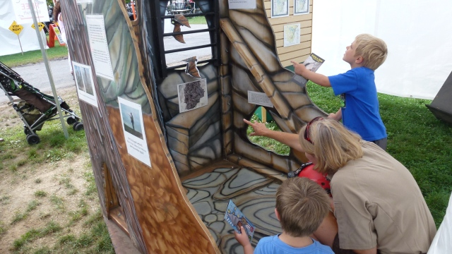 Visitors learn about bats in a hibernaculum. Credit: Bethany Holbrook
