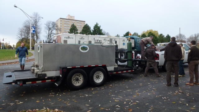 The Service's Genoa National Fish Hatchery truck and NYSDEC Oneida Fish Hatchery truck. The trucks had 3 or 6 compartments that are like giant coolers with thousands of fingerlings in them. Credit: USFWS