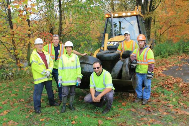LANE Construction got their heavy equipment to remove big trash from the Green River in Massachusetts and Vermont.