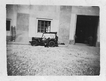 Darrell's father in front of a Signal Corps jeep in World War II. Image courtesy of Darrell.