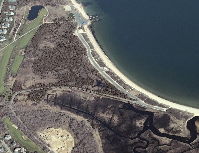 Here's an aerial view of Round Hill Marsh in Dartmouth, Mass. The central portion was filled nearly 100 years ago. Under the proposal, fill would be excavated from the historic salt marsh and tidal flow would be re-connected to restore up to 12 acres of salt marsh. The opportunity to reclaim this valuable coastal ecosystem is only possible because of a partnership and cost-sharing effort utilizing Bouchard oil spill settlement funds, New Bedford Harbor NRDAR settlement money, and a grant from the DOI Hurricane Sandy Resiliency effort. Credit: Massachusetts Division of Ecological Restoration.