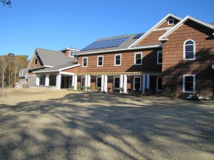 A rooftop solar array similar to the one pictured here is being designed and installed at the Great Swamp visitor center, which will make its electrical system more resilient to future storms. (Credit: USFWS)