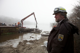 The Service oversees work being done to remove debris from fragile marsh areas.  (Credit Ryan Hagerty/USFWS)