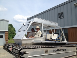Frank Drauszewski, Deputy Refuge Manager, and Frances Toledo Rodgriguez, Invasives Coordinator at Parker River Refuge, use the Marshmaster, specialized low-pressure equipment sensitive to tidal marsh wetlands, to spray and remove invasive plant species in the Great Marsh. Credit: Margie Brenner/USFWS