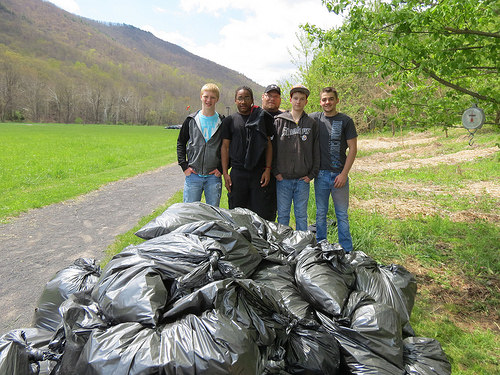 Students from the Elkins Mountain School in Elkins, West Virginia, participate in Garlic Mustard Challenge, filling bags of the invasive species. Photo from U.S. Forest Service.