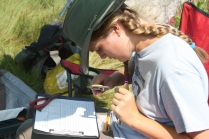 Research Specialist Christina Cerino measures a captured bird for the SHARP survey. Credit: Charlotte Murtishaw/USFWS
