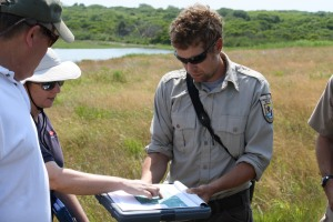 Nick Ernst and Marci Cole Eckberg discuss marsh elevation at Sachuest Point National Wildlife Refuge. Credit: Tom Sturm/USFWS