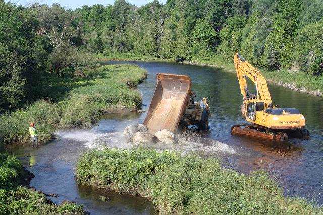 Boulders are placed in the Meduxnekeag River to create more natural aquatic habit for fish. Photo credit: USFWS