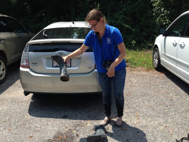Charlotte Murtishaw, SCA and Hurricane Sandy Youth Storycorps intern, empties her boot after a day filming and photographing students, scientists and sparrows for a Hurricane Sandy science resilience project in Stonington, Conn. via USFWS