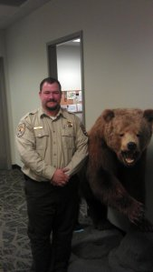 From left to right: Kyle Covill, a bear. via USFWS