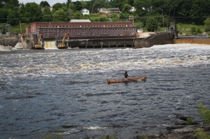 A member of the Penobscot Indian Nation paddles a canoe by the area where Veazie dam once stood. Photo Credit: Meagan Racey, USFWS