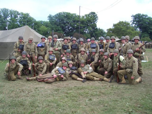 Damian (standing on the far right) gathers at the re-enactment with members of Dog Company, 16th Infantry,  1st Infantry Division. Photo: Damian Martelli