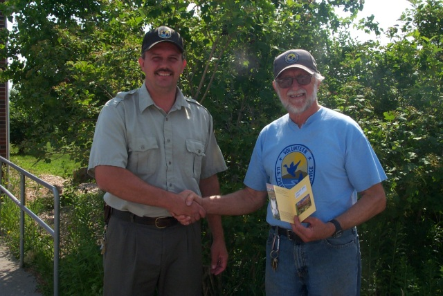 Bob receives a volunteer pass. Credit: USFWS