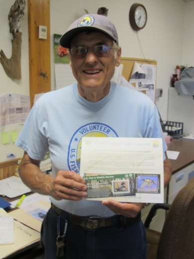 Carl holds up the Duck Stamp sales. Have you bought yours?! Credit: USFWS