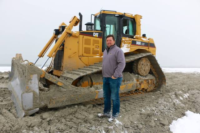 Boomer Heun, the supervising contractor and operator of every machine out here, stands in front of a bulldozer. Photo courtesy NJ Audubon/Larry Niles