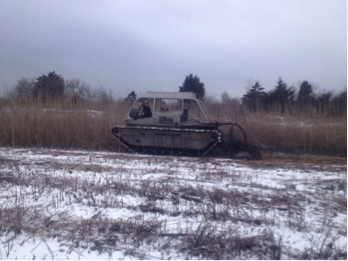 Amber operating a MarshMaster to restore habitat on private lands as part of our Partners for Fish and Wildlife Program. Photo courtesy of Amber.
