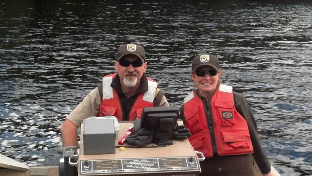 Amy with biologist Scott Schlueter out collecting information for an eel study evaluating effects of contaminants on reproduction. Photo courtesy of Anne.