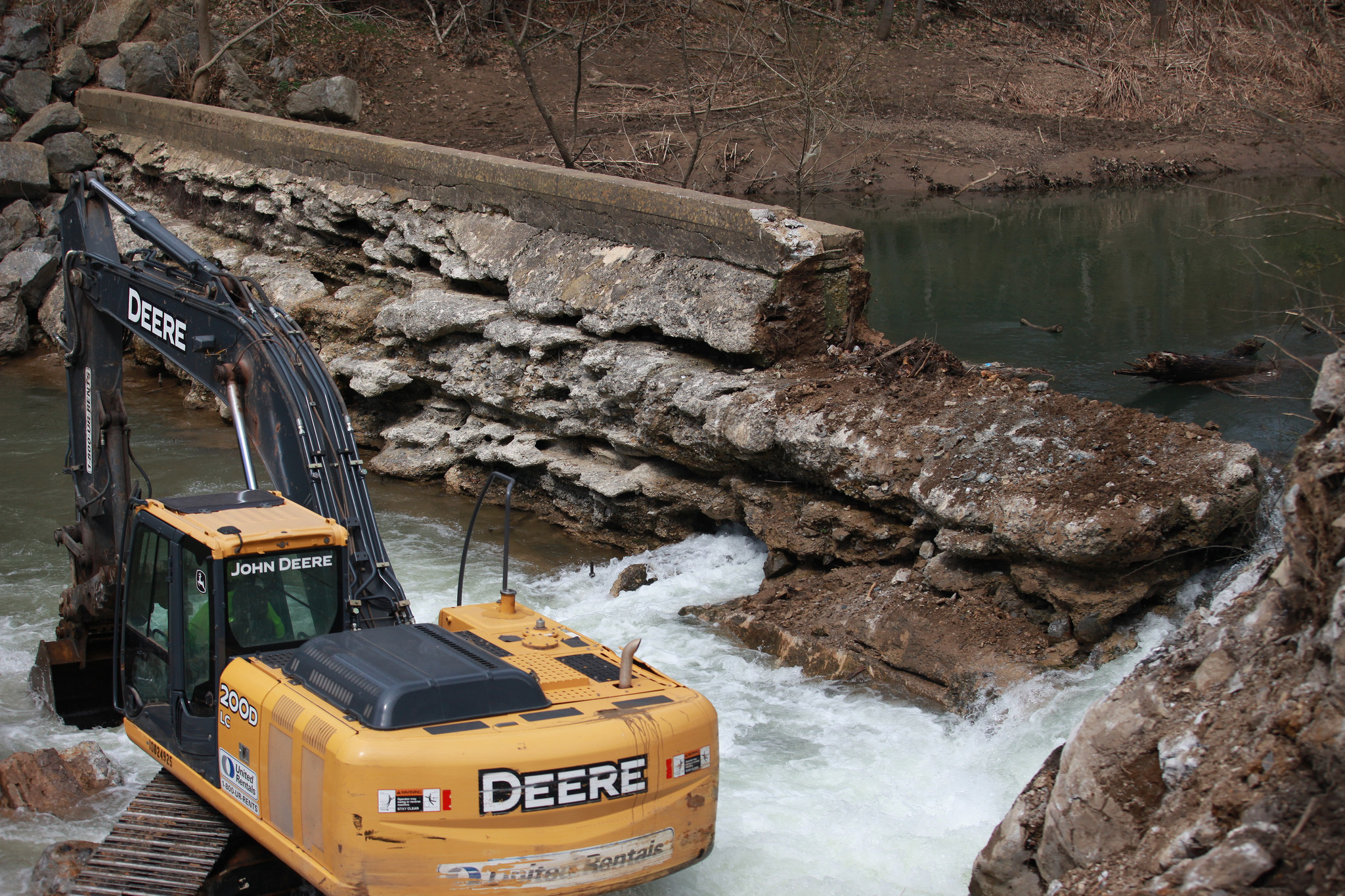 The excavator pictured next to the dam. As you can see, the dam had already been breached. Credit: Tom Barnes / USFWS