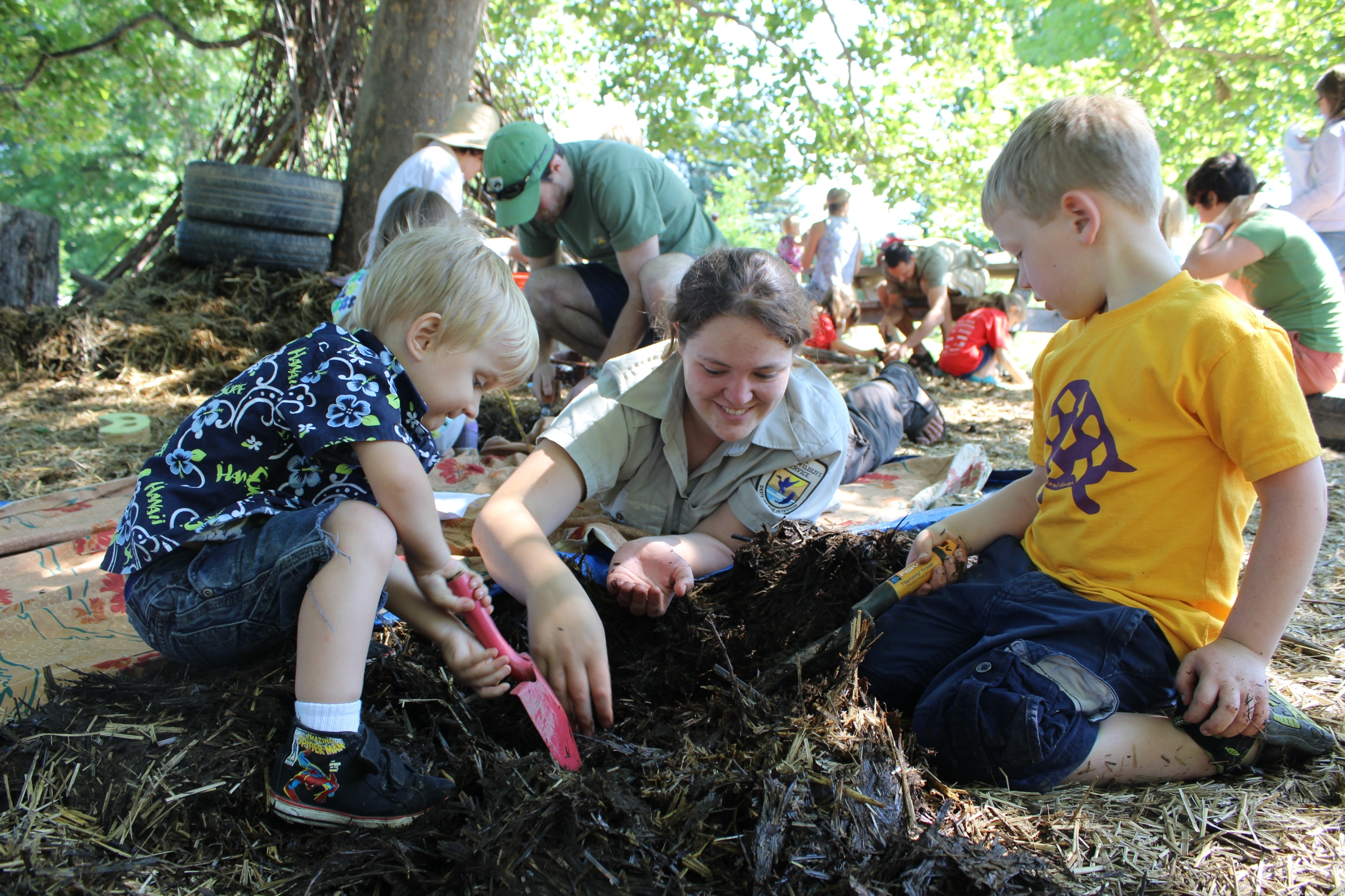 Andrea has been the outreach coordinator in our New York office. Here she and children explore for worms, insects, amphibians, and birds at the Hands-on-Nature Anarchy Zone during Zone into Nature, a program series that Andrea organized and facilitated.