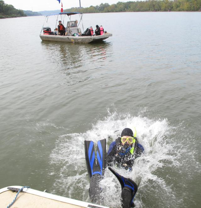 U.S. Fish and Wildlife Service diver Doug Canfield splashes into the water in preparation for mussel work! Credit: USFWS