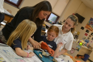 Jenny Paterno dissects and oyster with curious students at Assumption school. Credit: Cathryn Flammer/Assumption School