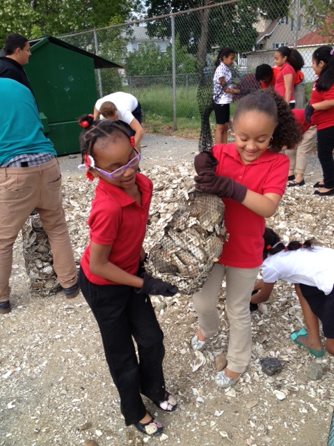 Boys and Girls Club of Vineland builds shell bags for Gandy's Beach oyster reef. Credit: Project PORTS staff