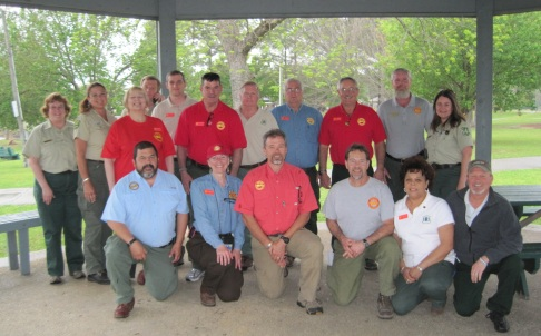 Red Team Incident Commander Mike Dueitt  of the U.S. Fish and Wildlife Service (kneeling center) was a friend of Steve Cobb. His team's service honored the fallen firefighters.