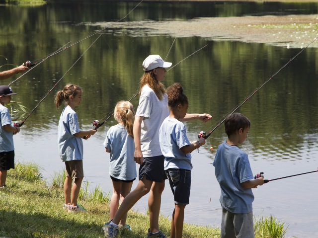 Fishing is a great way for kids and families to get outdoors, spend time together, and learn about the natural world that surround neighborhoods. Photo credit: Mike Beauchene, CT DEEP