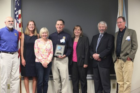 Eric Derleth, center, received the prestigious John S. Gottschalk Partnership Award in 2014 for success in building diverse and productive partnerships - vital to the Service fulfilling it's conservation mission.  Credit: USFWS