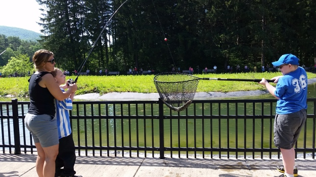 """Fishing with a """"buddy"""" can be useful when you need help netting a big fish! Photo credit: USFWS"""