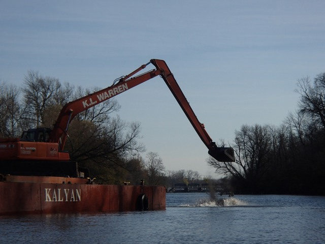 A crane distributes 400 tons of rock to create spawning reefs in the river. Photo credit: USFWS