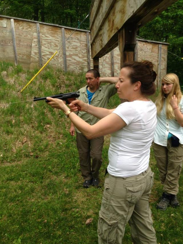 Learning to use the dart gun is part of the course curriculum. Here we are instructed by John McDonald. Photo Credit: Bennett Gould
