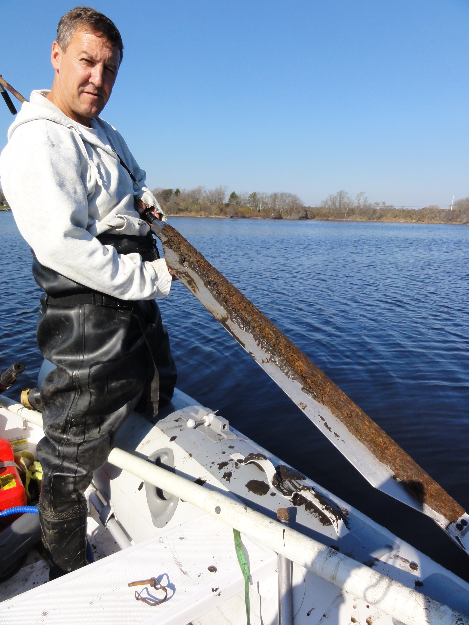 Jim Turenne holds a peat sample from what was a freshwater cedar swamp – now a tidal system and pond. Credit: Soil Survey Staff