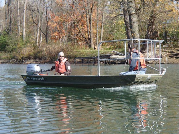 Fish biologist Betsy Trometer asssess habitat on the river. Photo credit: USFWS