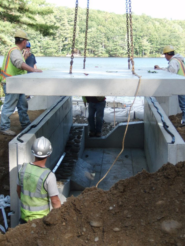 Installing the new culvert. Photo Credit: Karen Robbins